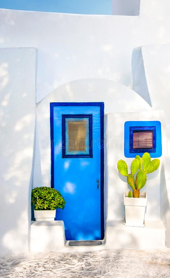 Beautiful old blue door, blue window on white facade of greek architecture and potted flowers, Santorini island, Greece, Europe. Beautiful details of the stock photography