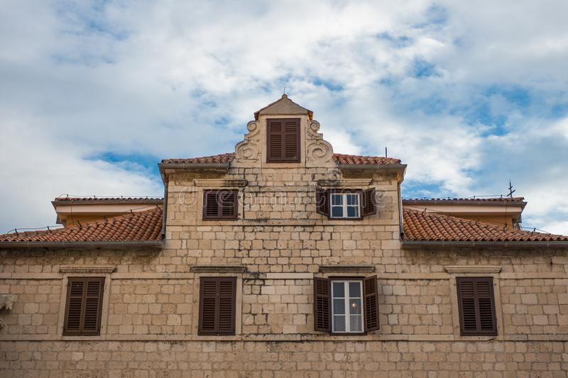 Beautiful old building in Zadar, Croatia with blue cloudy sky royalty free stock photo