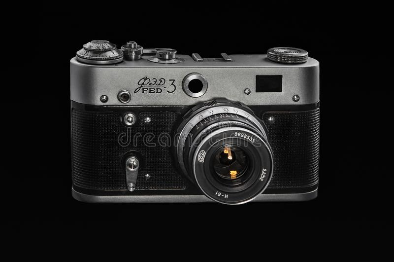 Beautiful old camera FED-3 with lens, black background stock image