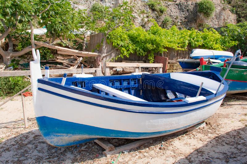 Beautiful old colored fishing wooden boats royalty free stock photo