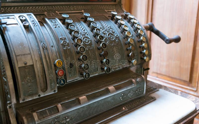 Beautiful, old counting machine with round buttons. Ancient cash register. stock photo