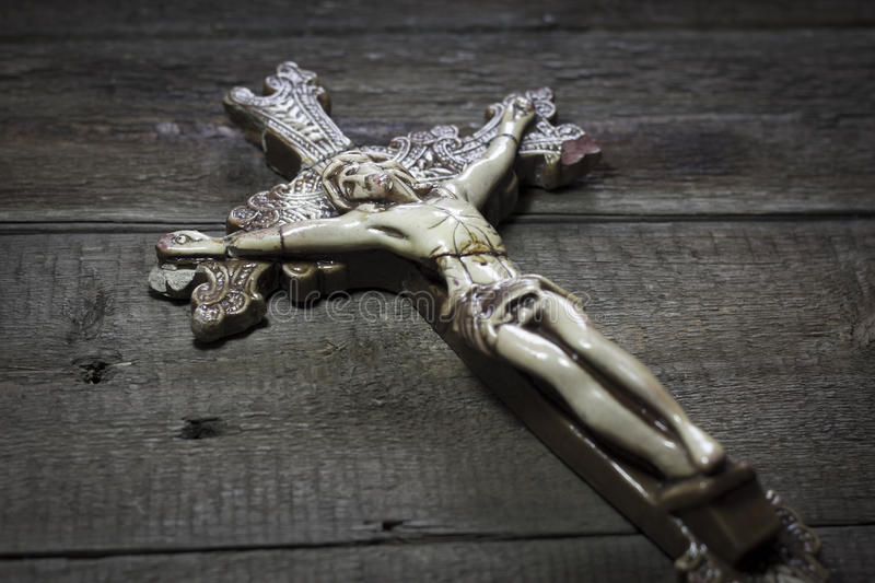 Beautiful old cross with jesus on the old wooden floor royalty free stock photo
