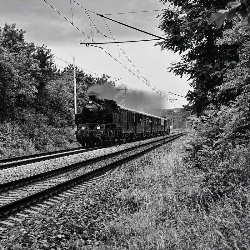 Beautiful old Czech train with steam locomotive. Concept for retro, travel and train travel. Train tracks and a cruise train in th royalty free stock images