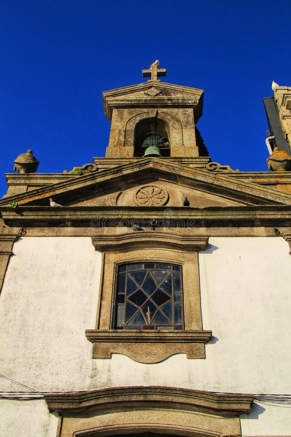 Beautiful stone facade of old parish in Oporto. Beautiful and old facade of an old parish on the banks of the Douro river in Oporto, Portugal european church stock photos