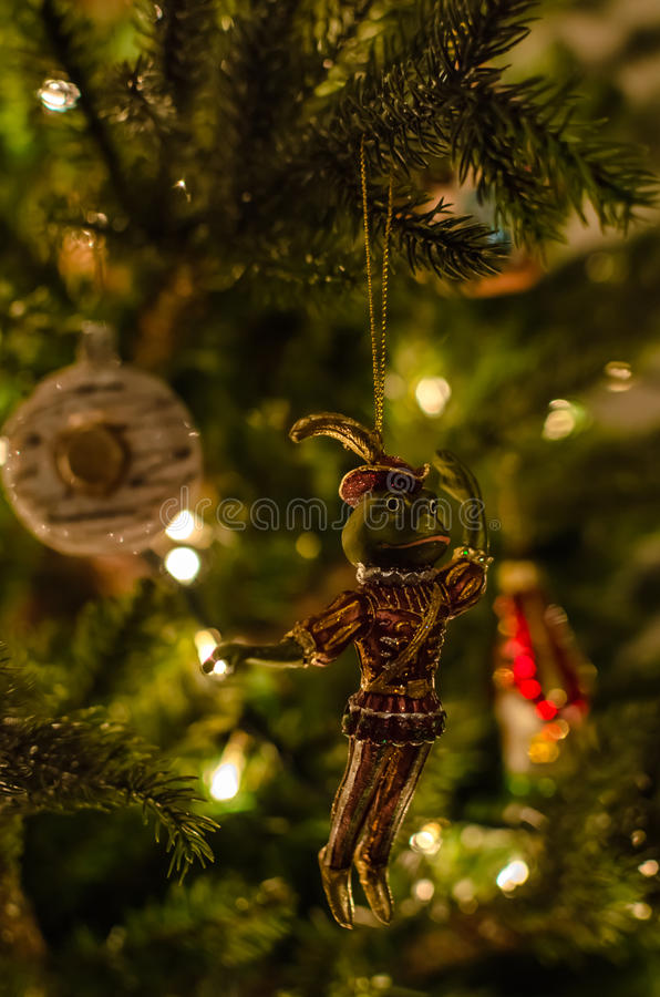 Beautiful retro christmas toy of prince frog and lights background on christmas tree. Old fashioned, retro christmas toy of prince of frog on christmas tree stock images