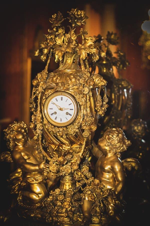 Old gold clock stock photos