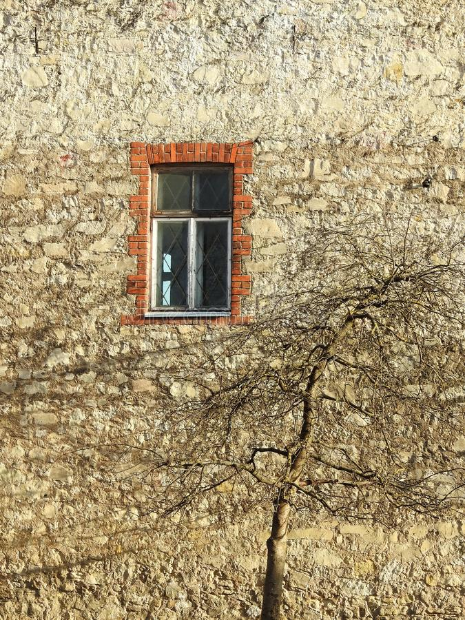 Old home wall and window, Latvia royalty free stock photo