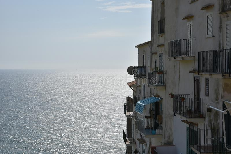 Beautiful old houses with balconies  in Sperlonga village. The sea on background. Sperlonga, Lazio, Italy royalty free stock photos