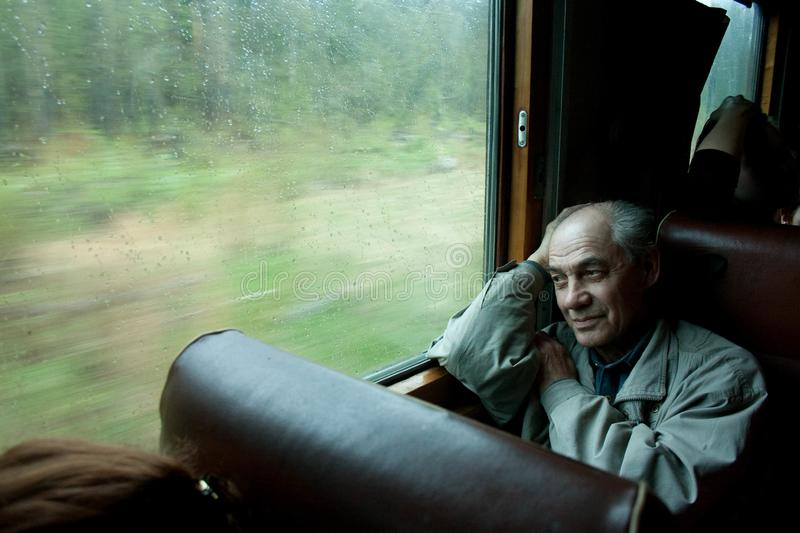 Beautiful old man in the train royalty free stock photos