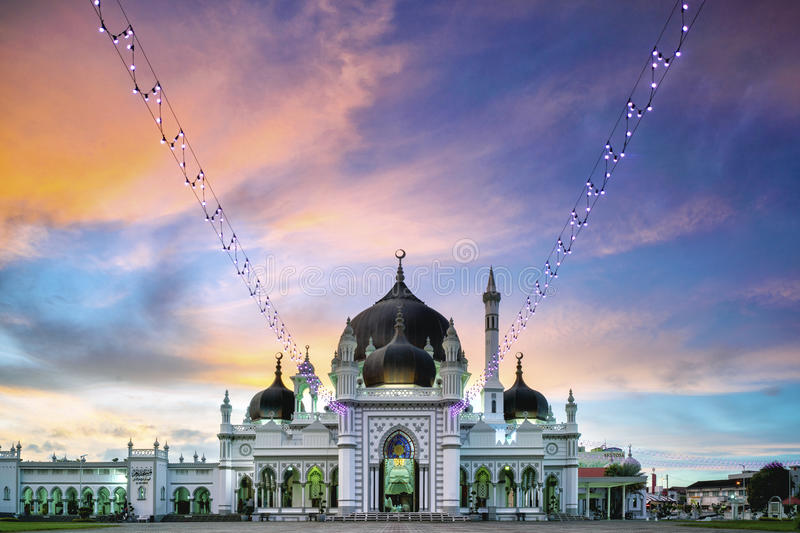 Beautiful old mosque during sunset with colorful sky stock images