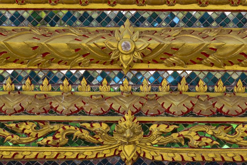Texture close-up. Beautiful old ornament on the wall of a Thai h royalty free stock image