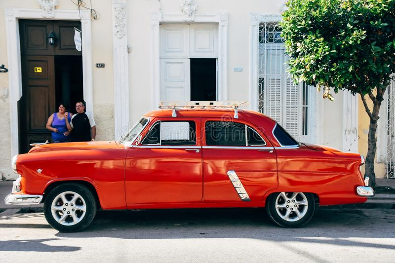 A beautiful old red classic car in Cienfuegos, Cuba. stock photography