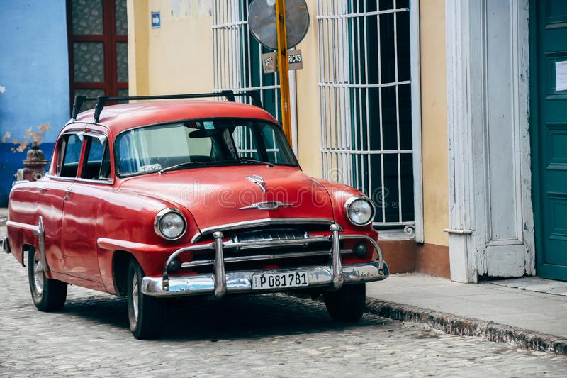 A beautiful old red classic car in Trinidad, Cuba. A beautiful old red classic car parked in Trinidad, Cuba royalty free stock photos