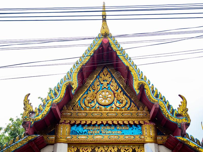 Beautiful old roof is texture colors Gold,Designed by Thai people,Temple name is Wat kaew at Bangkok Thailand. Beautiful old roof is texture colors Gold,Designed stock photo