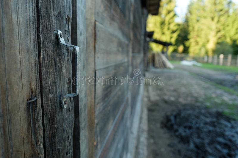 Beautiful old rustic wooden barn door with a handle. Close up stock photos