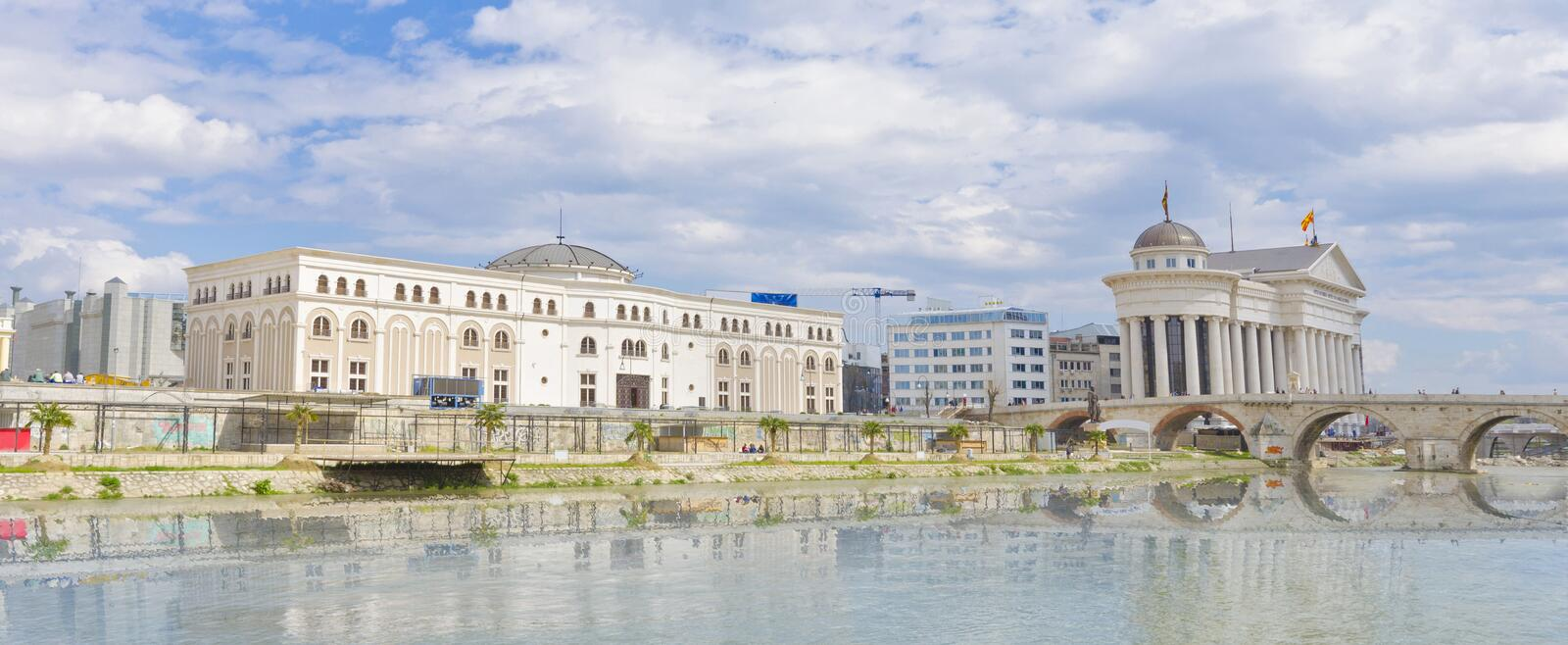 Beautiful old stone bridge and archaeological museum in Skopje, Macedonia. Beautiful old stone bridge and archaeological museum of Macedonia, Vardar river wather stock image