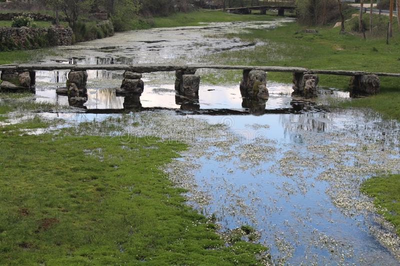 Beautiful and old stone bridge very old that allows us to pass the river royalty free stock photos