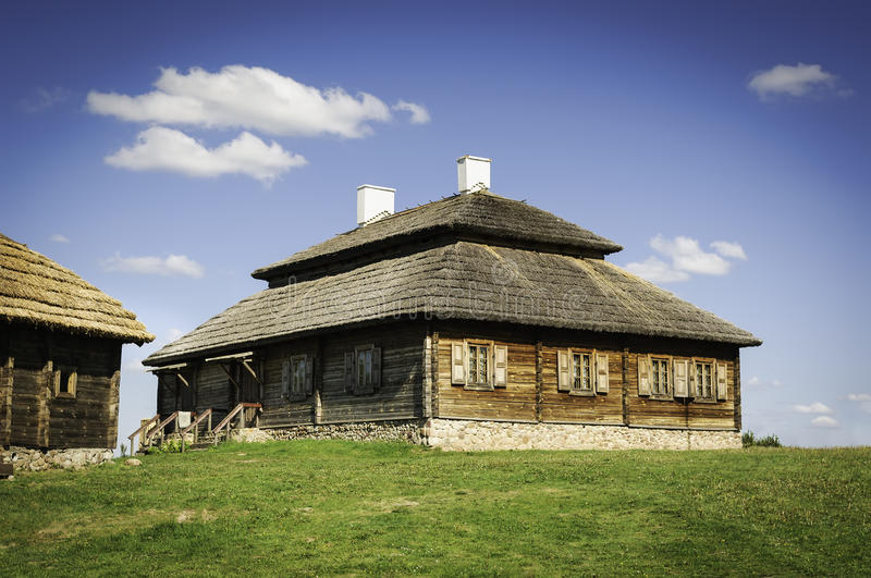 Beautiful old style farmhouse with thatch roof. Beautiful landscape with restored old style russian farmhouse with thatch roof stock images