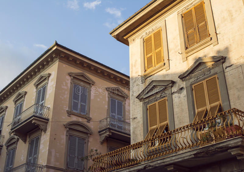 Beautiful, old sunlit house facades in Levanto, Italy. In the golden hour royalty free stock image
