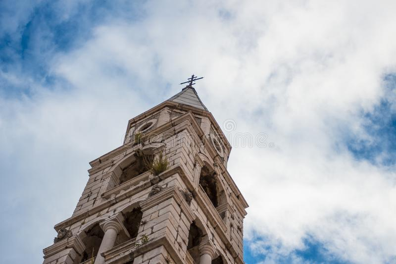 Beautiful old tower in Zadar, Croatia with blue cloudy sky royalty free stock photo