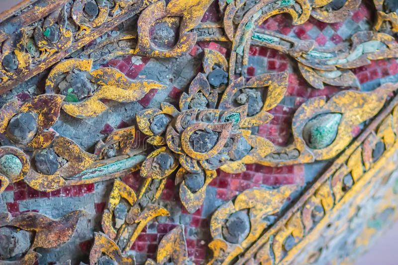 Beautiful old traditional Thai style craving patterned of royal barge. Old golden craved pattern of Thai wooden royal barge. Beautiful old traditional Thai royalty free stock photography