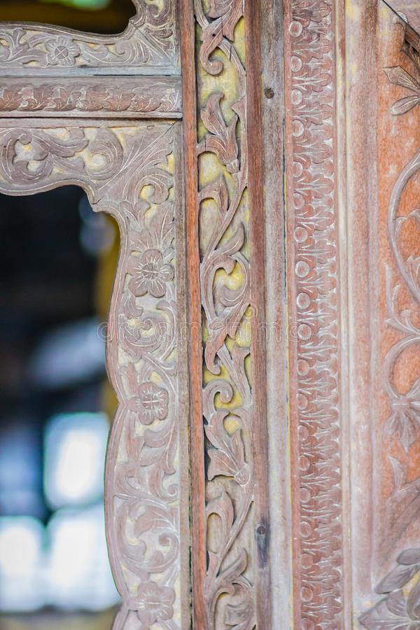 Beautiful old traditional Thai style craving patterned of royal barge. Old golden craved pattern of Thai wooden royal barge. Beautiful old traditional Thai stock image