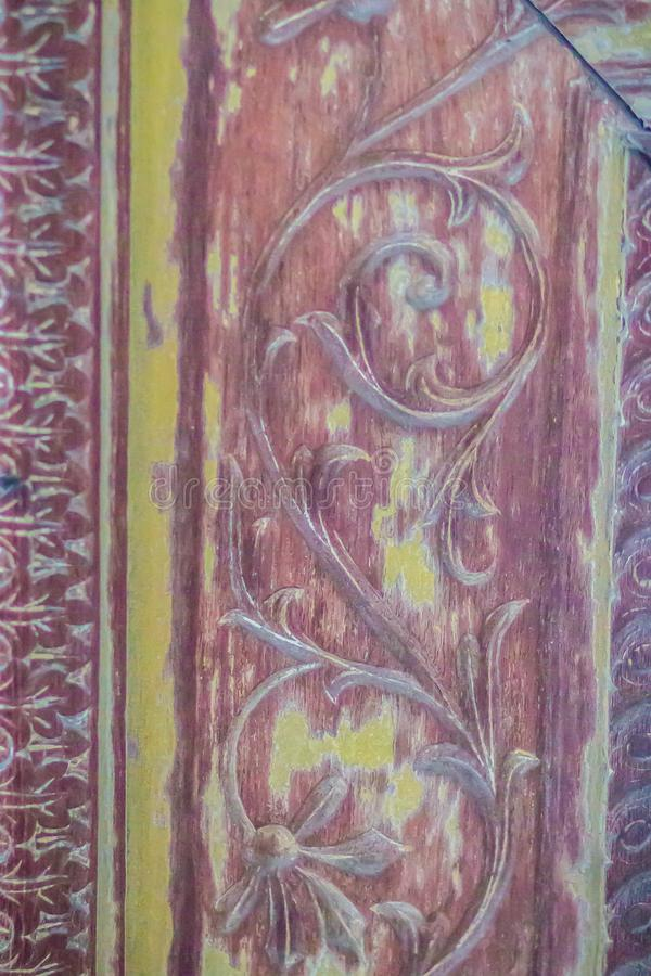 Beautiful old traditional Thai style craving patterned of royal barge. Old golden craved pattern of Thai wooden royal barge. Beautiful old traditional Thai royalty free stock image