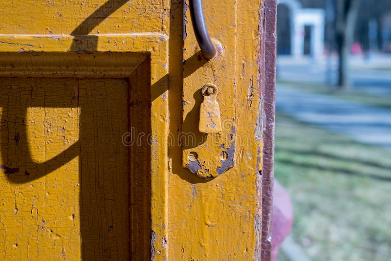 Beautiful old, vintage, rustic, cracked turquoise paint wooden door and rusty iron lock and keyhole as a background stock photography