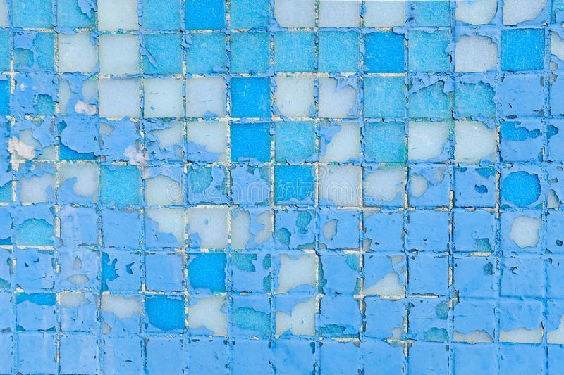 Beautiful old wall decorative, colorful small mosaic texture, shabby squares. Decorative colored tiles. Repair of interior and royalty free stock photos