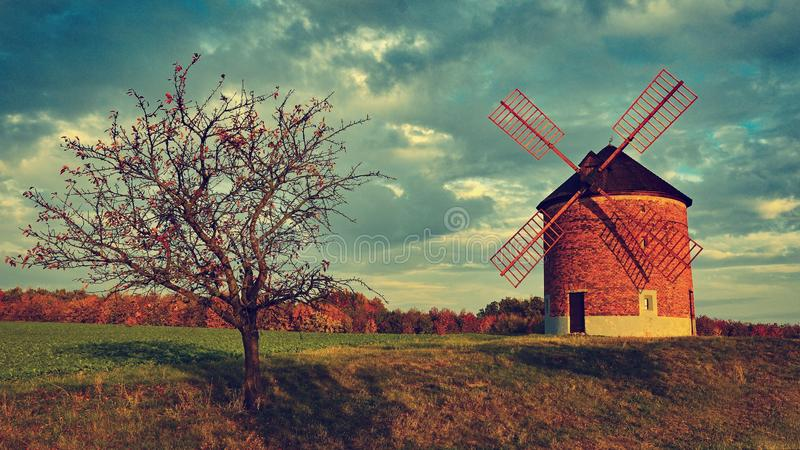 Beautiful old windmill. Landscape photo with architecture at sunset golden hour. Chvalkovice - Czech Republic - Europe. stock photo