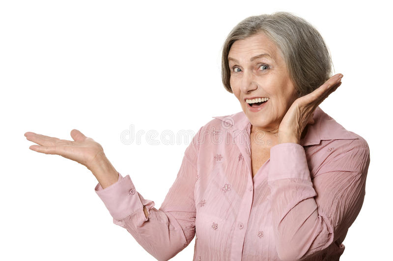 Beautiful old woman. Portrait of surprised beautiful old woman on a white background royalty free stock image