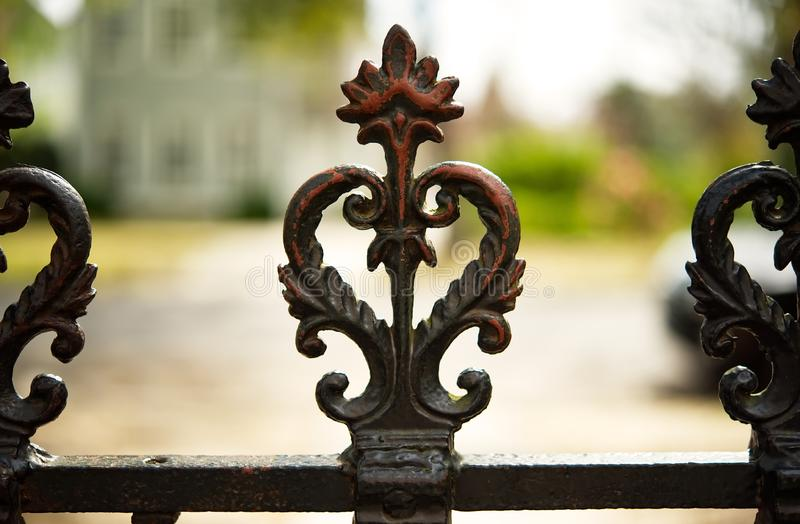 A closeup of the top of a wrought iron fence in Georgetown, SC. royalty free stock images