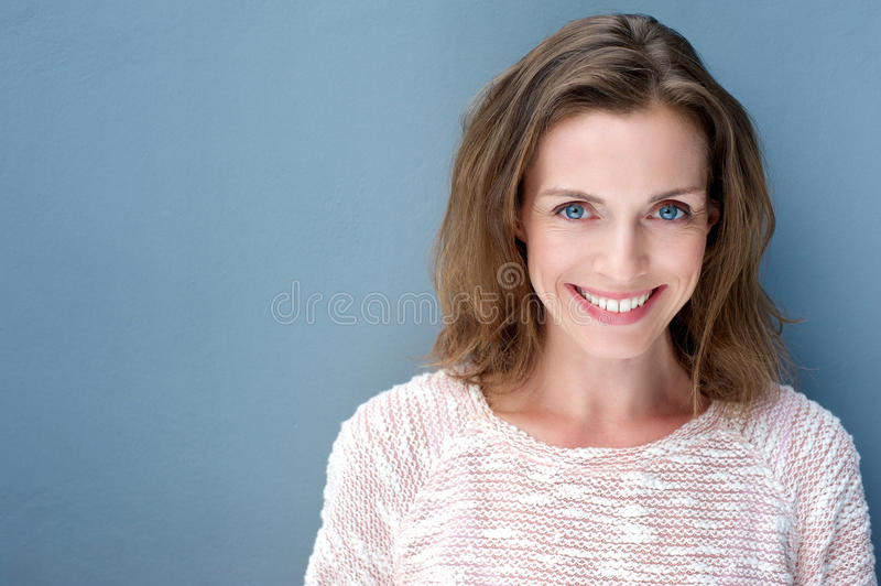 Beautiful older woman smiling with sweater royalty free stock image