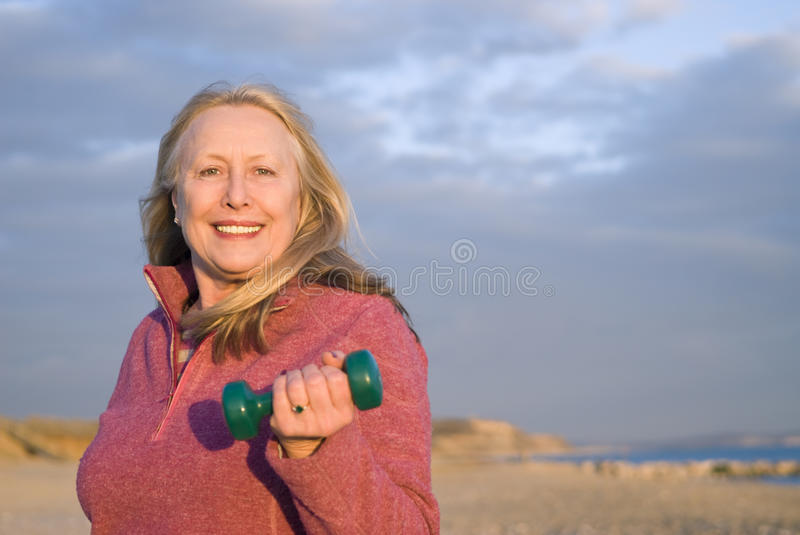 Beautiful older woman working out. royalty free stock photo