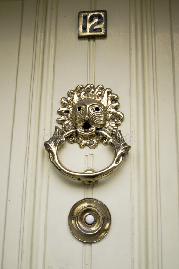 Beautiful oranate bronze door knocker stock photos