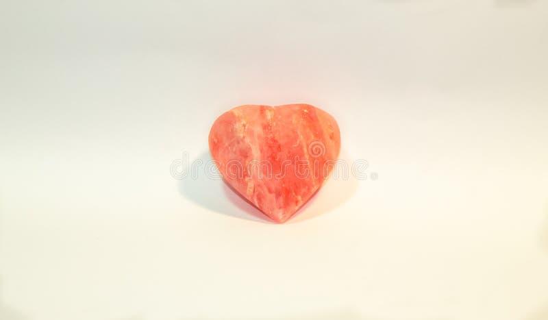 Orange heart from salt stock photo