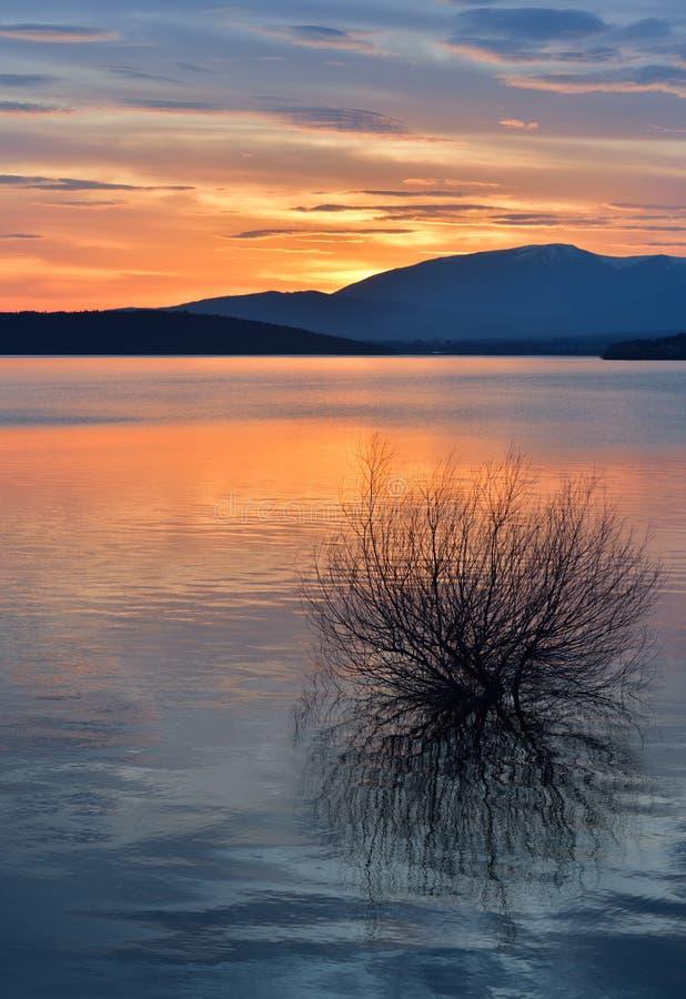 Beautiful Orange Nature Background.Sunset,sunrise.Artistic Wallpaper.Art Photography.Sky,clouds,water.Lake,trees.Mountain.Light. royalty free stock image