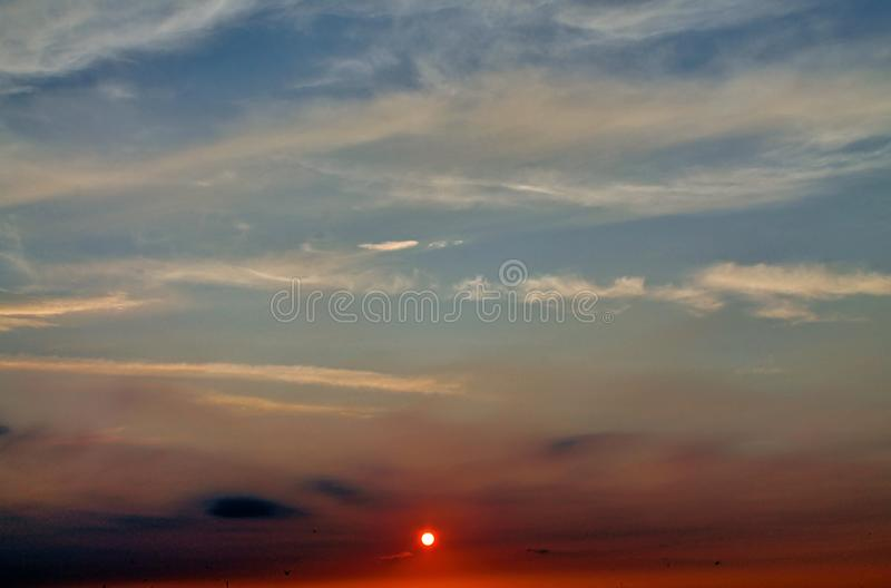 Beautiful orange and red sunset cloud formations in the sky royalty free stock image