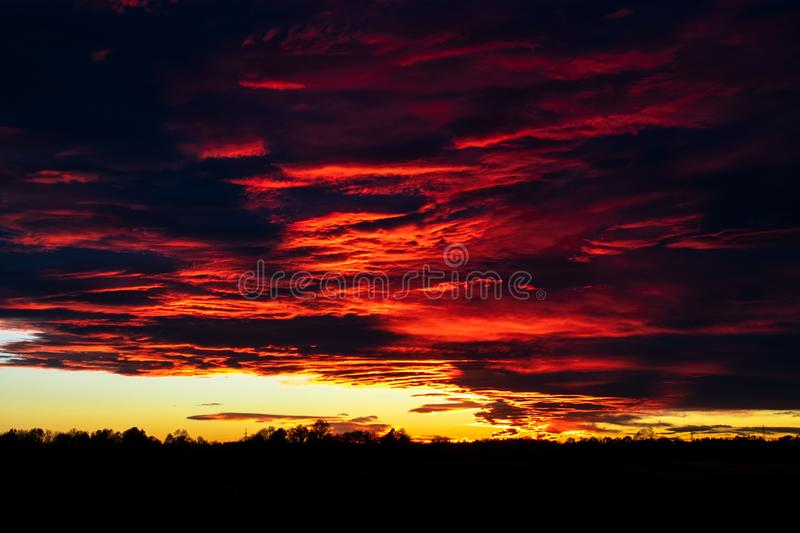 Beautiful orange and red sunset with colorful clouds. A beautiful orange and red sunset with colorful clouds stock images