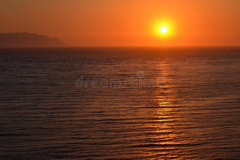 Beautiful Orange Sea Sunset and Calm Water royalty free stock image