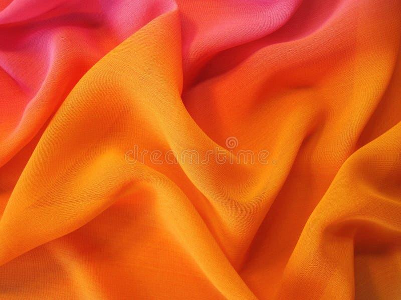 Beautiful orange silk fabric texture stock images