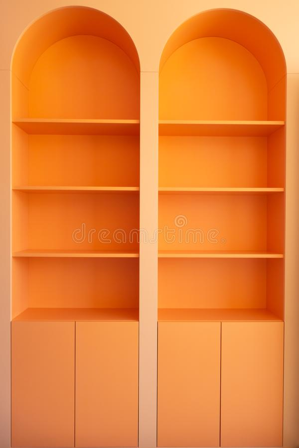 Beautiful orange wardrobe with arched elements. Creative vintage background. Space, bright, modern, symbol, empty, blank, light, technology, art, black, design royalty free stock photography