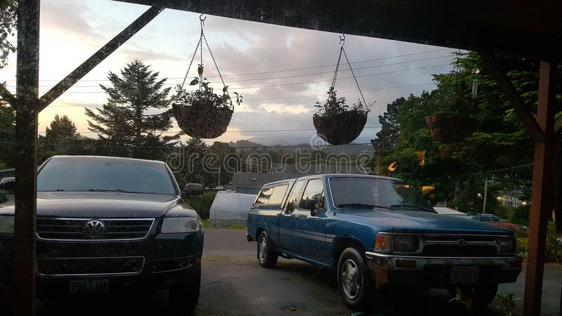 Beautiful Oregon sky with hanging planters stock photography