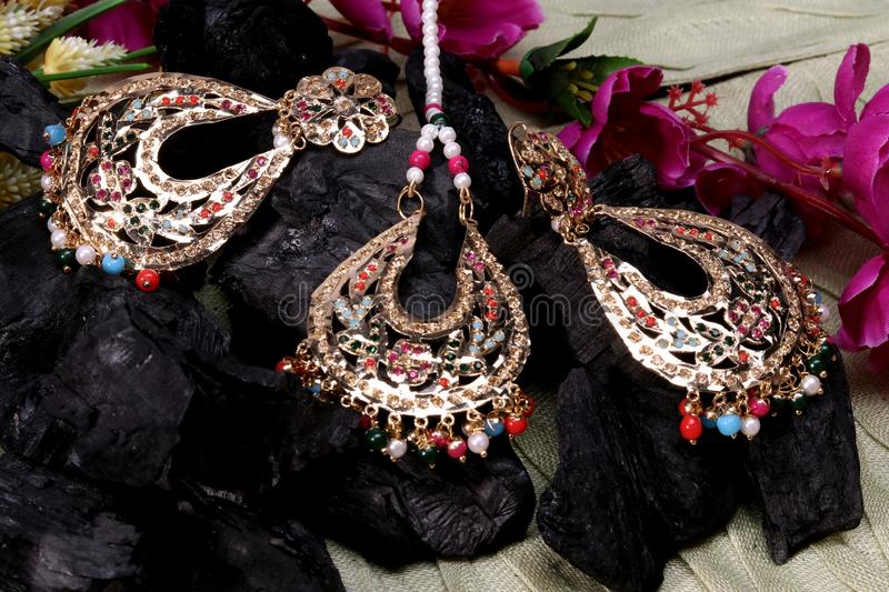 Beautiful Oriental artificial gold jewelry Indian, Arab, African, Egyptian. Fashion Exotic Accessories, Asian Gold jewelry. T. Ribal Jewelry for belly dance royalty free stock image