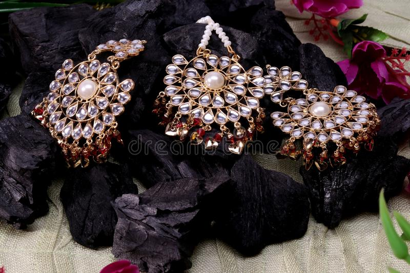 Beautiful Oriental artificial gold jewelry Indian, Arab, African, Egyptian. Fashion Exotic Accessories, Asian Gold jewelry. T. Ribal Jewelry for belly dance royalty free stock photo
