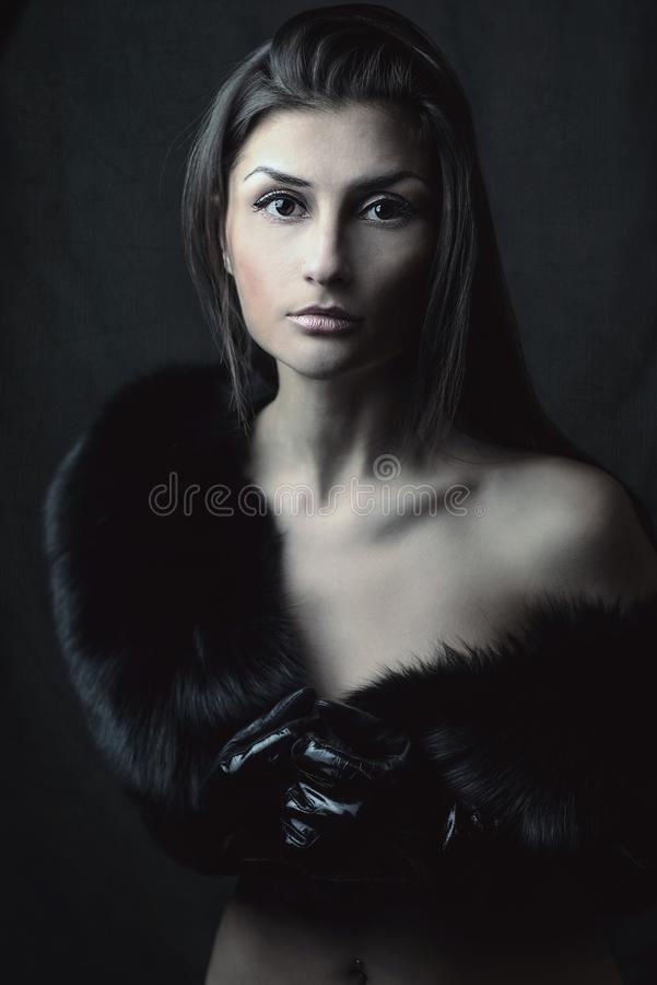 Beautiful Oriental girl with almond eyes in furs royalty free stock photos