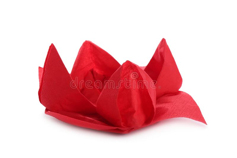 Beautiful origami flower made of red napkin royalty free stock image