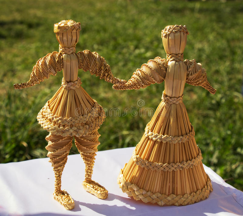 Beautiful original straw doll is made on motives of folk traditions. And crafts of Russia stock photos