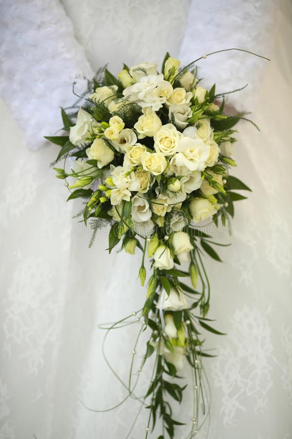 Beautiful original wedding bouquet. Of fresh flowers on a festive day royalty free stock image