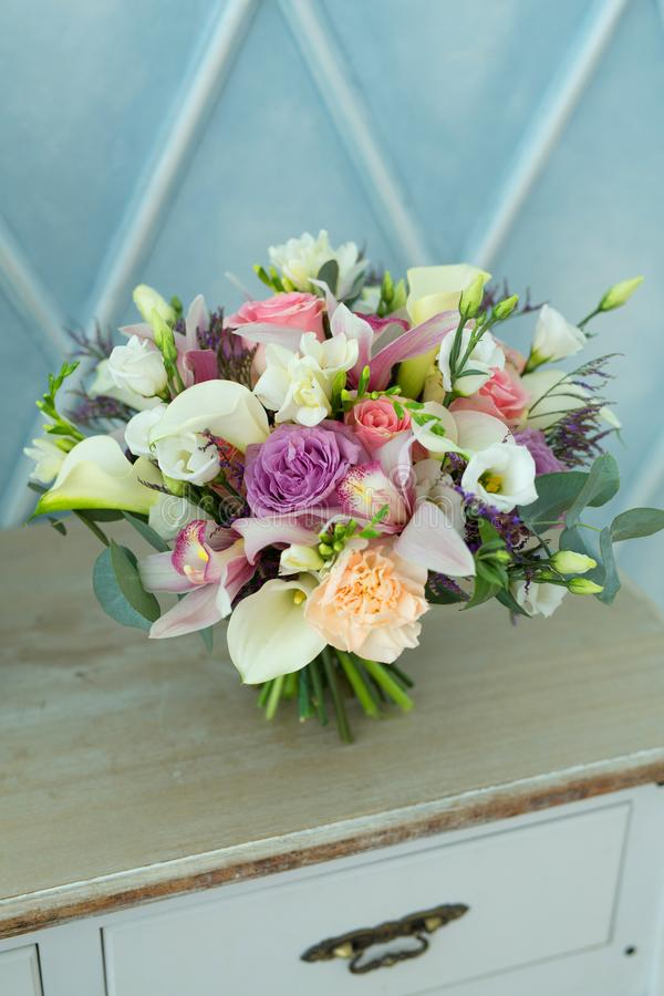 Beautiful original wedding bouquet. Of fresh flowers on a festive day stock images